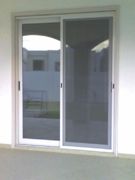 Ventanas vidrio y aluminio meller for Puerta corrediza de aluminio